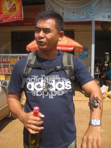 Tour Guide Sam With Tarantulas On His Arm And Chest