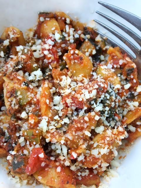 Chickapea Pasta Dish Topped With Parmesan