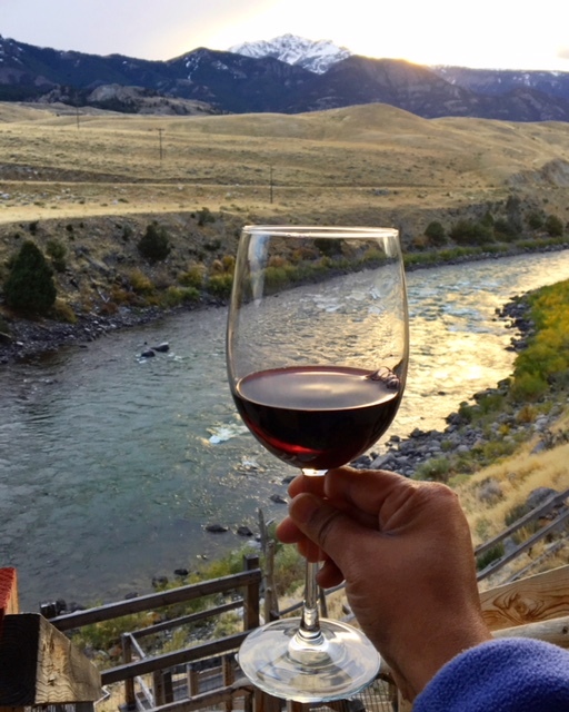 Enjoying Wine At Sunset Looking Out Into Yellowstone National Park