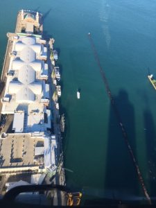Flying Over Navy Pier With Cool Shadows Of Lake Point Tower